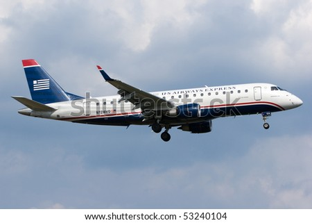 WASHINGTON, DC - MAY 5: U.S. regulators are demanding that US Airways auction off slots at Reagan Airport, to create openings for other airlines. US Airways aircraft on May 5, 2010 in Washington, DC. - stock photo