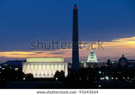 Washington DC National Mall at sunrise, including Lincoln Memorial, Monument and United States Capitol building - stock photo