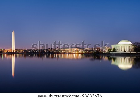 Washington DC National Mall, including Washington Monument and Thomas Jefferson Memorial with mirror reflections on water - stock photo