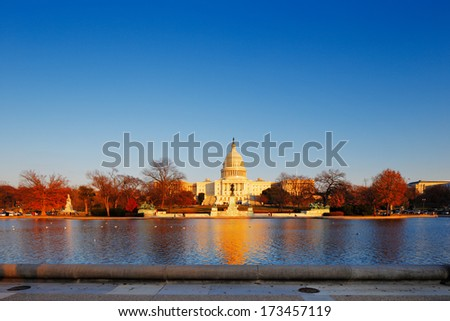 WASHINGTON DC - NOV 30: The United States Capitol behind the Capitol Reflecting Pool on Nov 30, 2013 in Washington DC, USA. It is the meeting place of the United States Congress. - stock photo