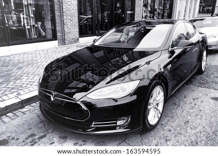 WASHINGTON, DC - November 2013: Tesla Motors model S sedan electric car is parked while NHTSA investigates fire incident with this advanced battery powered automobile on November 2013 in Washington DC - stock photo
