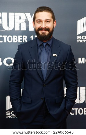 "WASHINGTON, DC-OCT 15: Actor Shia LaBeouf attends the world premiere of ""Fury"" at the Newseum on October 15, 2014 in Washington DC. - stock photo"