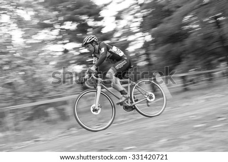 WASHINGTON DC - OCTOBER 24: A cyclist competes in the DC cyclocross competition on October 24, 2015 in Washington, DC - stock photo