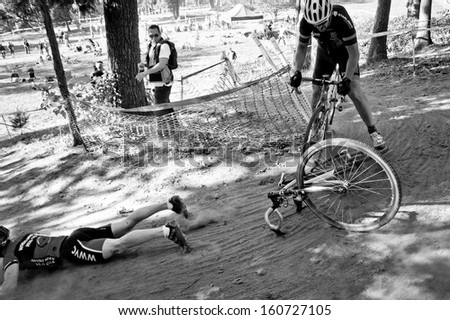 WASHINGTON DC - OCTOBER 20:  A cyclist is thrown from his bike during the DC cyclocross competition on October 20, 2013 in Washington, DC
