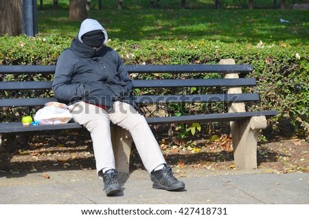 WASHINGTON,DC - OCTOBER 24: Homeless people at Dupont Circle on October 24, 2015 in Washington, DC USA. One of the most busy metro stations in Washington, DC. - stock photo