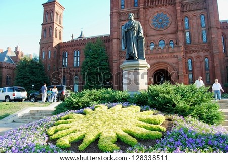 WASHINGTON, DC - OCTOBER 21: Smithsonian Castle on October 21, 2012 in Washington DC,USA. Smithsonian Castle is a famous attraction in Washington DC, and people from all over the world come to visit. - stock photo