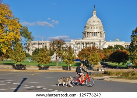 WASHINGTON, DC - OCTOBER 21: Washington DC Capitol on October 21, 2012 in Washington DC,USA. The Capitol is a famous attraction in Washington DC, and people from all over the world come to visit. - stock photo
