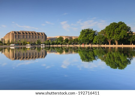 Washington, DC office building mirrored in the water of the US Capitol Reflecting pool. - stock photo