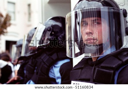 WASHINGTON, DC - SEPT 27: Police in full riot gear and batons guard Gap stores during anti-sweatshop protests on Sept. 27, 2002 in Washington, DC. - stock photo