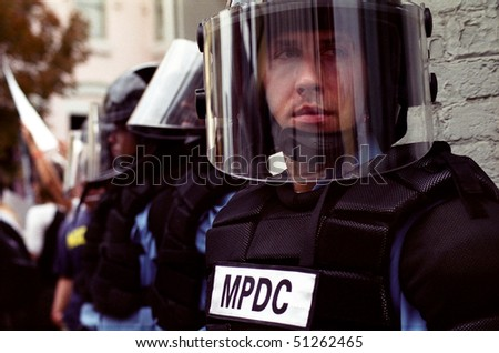 WASHINGTON, DC - SEPT 27: Police in full riot gear and batons guard Gap stores during anti-sweatshop protests on Sept. 27, 2002 in Washington, DC - stock photo