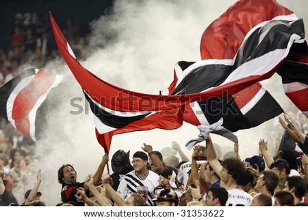 WASHINGTON, DC - SEPTEMBER 9:  DC United supporters celebrate a goal during a Major League Soccer match against Real Salt Lake at RFK Stadium in Washington, DC September 9, 2006. - stock photo