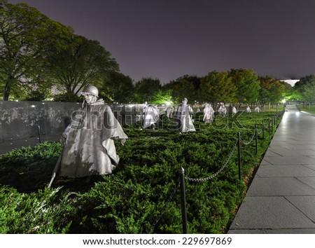 WASHINGTON, DC - SEPTEMBER 27, 2013: Korean War Veterans Memorial at night, located in National Mall in Washington, DC. The Memorial commemorates those who served in the Korean War. - stock photo