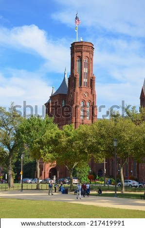 WASHINGTON, DC - SEPTEMBER 14: Smithsonian Castle on September 14, 2014 in Washington DC,USA . People from all over the world come to visit the Smithsonian Castle. - stock photo