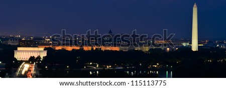 Washington DC skyline at night, including Lincoln Memorial, Washington Monument and Arlington Memorial Bridge - stock photo