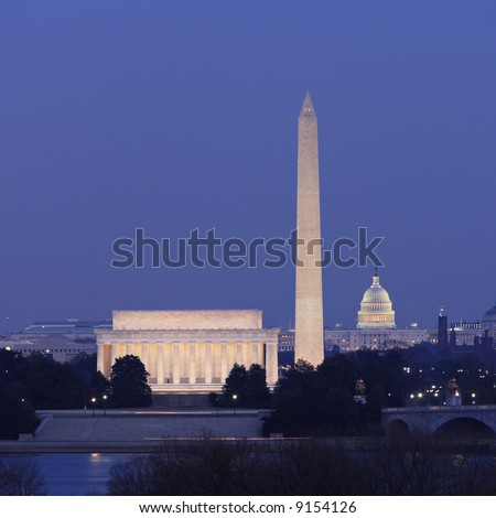 Washington, DC skyline at night showing the Lincoln Memorial, Washington Monument and United States Capitol building. - stock photo