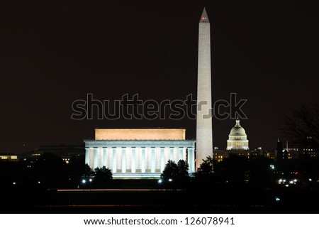Washington DC skyline view with Lincoln Memorial, Washington Monument and US Capitol Building at night - stock photo