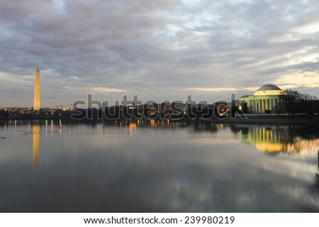 Washington DC - Thomas Jefferson Memorial with mirror reflections on water in a cloudy sunrise  - stock photo
