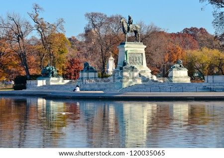 Washington DC = Ulysses S. Grant Cavalry Memorial in front of US Capitol Hill in Autumn - stock photo