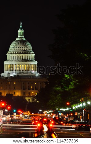 Washington DC, United States Capitol building at night with car lights trails