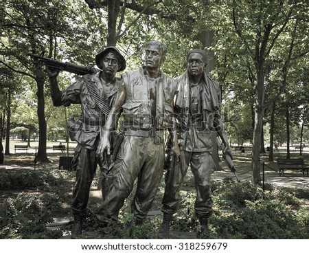 Washington DC, United States of America - June 24, 2007 : Vietnam war memorial statues  named 'The Three Soldiers' sculpted by Frederick Hart located in National Mall,  Memorial Parks ,Washington, DC - stock photo