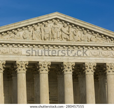 WASHINGTON, DC, USA - APRIL 06, 2015: United States Supreme Court building exterior. Equal Justice Under Law phrase engraved on facade.