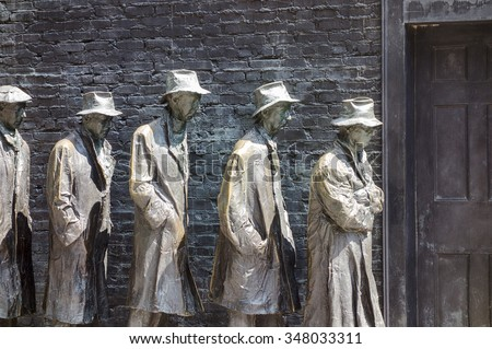 WASHINGTON DC, USA - AUGUST 20, 2014: An art installation at the Franklin Delano Roosevelt Memorial in Washington DC shows a bread line of five men to commemorate the Great Depression of the 1930s. - stock photo