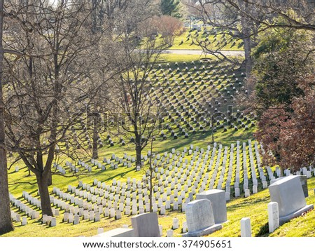 WASHINGTON DC, USA - DECEMBER 26, 2015: Gravestones on Arlington National Cemetery decorated for Christmas time.