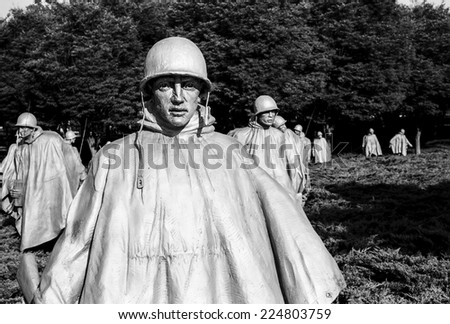 WASHINGTON DC, USA - JULY 17, 2014: A bronze figure of platoon leader leads his squad through the Korean War Memorial in Washington, DC. (Scanned from black and white film.) - stock photo