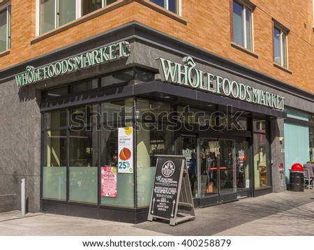 WASHINGTON, DC, USA - MARCH 30, 2016: People on sidewalk pass Whole Foods Market in Foggy Bottom neighborhood. - stock photo