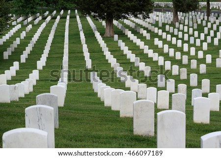 Washington DC, USA - May 31, 2016: Gravestones at Arlington National Cemetery; many people visit cemeteries and memorials, particularly to honor those who have died in military service.