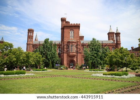 Washington DC, USA - May 28, 2016: Tourist visiting the The Smithsonian Institution Building in Washington, DC. Commonly known as The Castle.