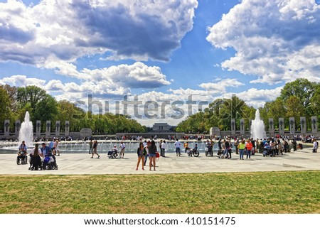 Washington DC, USA - May 2, 2015: War Veterans and guardians of Honor Flight nonprofit organization at National World War 2 Memorial, National Mall. Lincoln memorial in the middle on the background.
