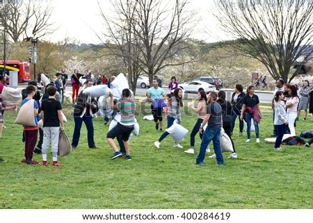 WASHINGTON DC, USA - Tourists enjoying a pillow fight at the Cherry blossom festival at the National Mall. The National Mall is a national park in downtown Washington, D.C.