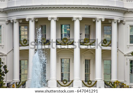 Washington DC, USA. White House detail with fountain and columns background.