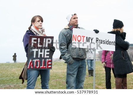 WASHINGTON  December 17: Protesters demonstrate against Donald Trump in Washington DC in anticipation of the December 19 meeting of the electoral college