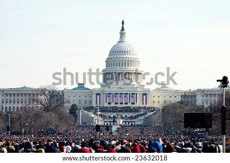 WASHINGTON - JANUARY 20: People marching towards the US Capitol building where President-elect Barack Obam will be inaugurated on January 20, 2009 in Washington. - stock photo