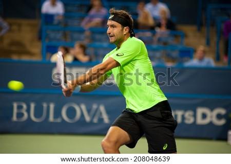 WASHINGTON - JULY 29: Marinko Matosevic during his losing match to fellow Australian Lleyton Hewitt (not pictured) at the Citi Open tennis tournament on July 29, 2014 in Washington DC - stock photo