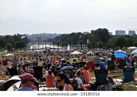 WASHINGTON - JULY 4: People are gathering on the National Mall in Washington DC for Independence Day celebrations on July 4, 2009. The Lincoln Memorial can be seen in the background. - stock photo