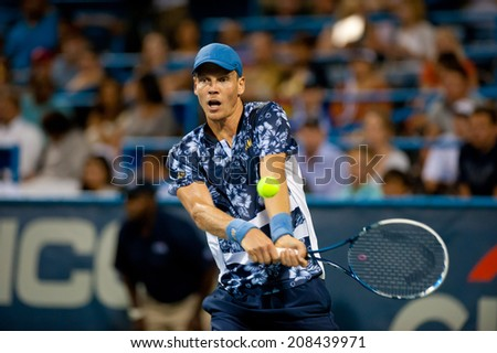 WASHINGTON - JULY 31: Top seed Tomas Berdych (CZE) falls, to Vasek Pospisil (CAN, not pictured) at the Citi Open tennis tournament on July 31, 2014 in Washington DC - stock photo