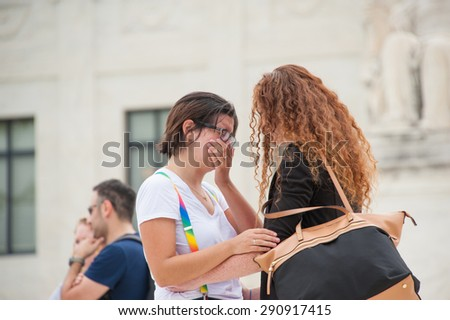 WASHINGTON June 26 - A couple reacts to the U.S. Supreme Court ruling legalizing same-sex marriage in all fifty states which was delivered on June 26, 2015 - stock photo
