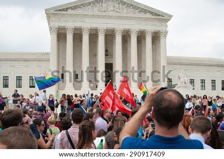 WASHINGTON June 26 - A crowd gathers at the U.S. Supreme opinion  after its ruling legalizing same-sex marriage in all fifty states was  delivered on June 26, 2015 - stock photo