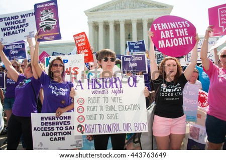 WASHINGTON JUNE 27:  A pro-choice activist holds a Planned Parenthood sign while awaiting the Supreme Courtâ??s ruling on abortion access in front of the Supreme Court in Washington, DC on June 27, 2016