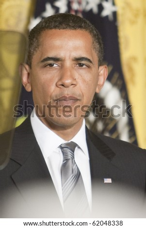WASHINGTON - JUNE 29: US President Barack Obama gives speech from the East Room of the White House June 29, 2009 in Washington, DC - stock photo