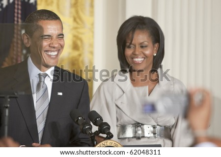 WASHINGTON - JUNE 29: US President Barack Obama with the first lady Michelle Obama next to him gives speech from the East Room of the White House June 29, 2009 in Washington, DC - stock photo