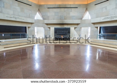 WASHINGTON - MARCH 19: The Hall of Remembrance located in US Holocaust Memorial Museum in Washington, DC on March 19, 2015. The walls are inscribed with the names of concentration and death camps. - stock photo