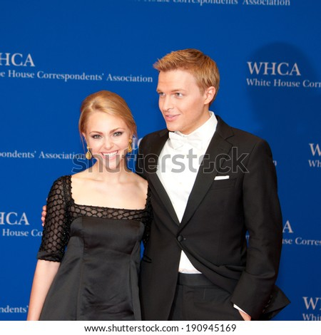 WASHINGTON MAY 3 -�� AnnaSophia Robb and Ronan Farrow pose on the red carpet at the White House Correspondents� Association Dinner May 3, 2014 in Washington, DC - stock photo