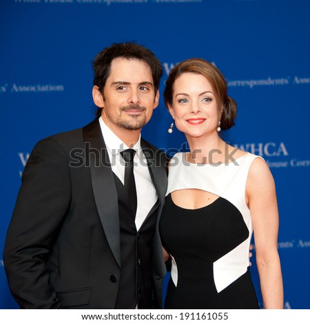 WASHINGTON MAY 3: Brad Paisley and wife Kimberly arrive at the White House Correspondents' Association Dinner May 3, 2014 in Washington, DC - stock photo