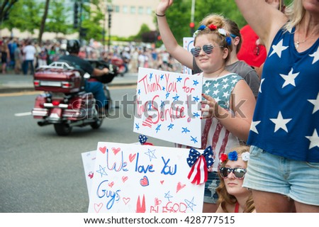 WASHINGTON MAY 29: Bystanders show their support at Rolling Thunder, a motorcycle rally to bring attention to POWs and MIAs of US-involved wars, on May 29, 2016 in Washington, DC.   - stock photo