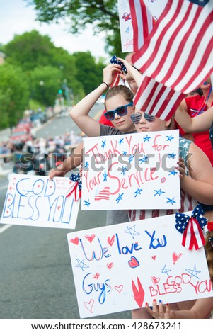 WASHINGTON  ?? MAY 29: Bystanders show their support for veterans at Rolling Thunder, a motorcycle rally to bring attention to POWs and MIAs of US-involved wars, on May 29, 2016 in Washington, DC.   - stock photo