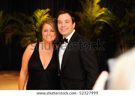 WASHINGTON MAY 1 - Jimmy Fallon and wife  Nancy Juvonen arrive at the White House Correspondents Association Dinner May 1, 2010 in Washington, D.C. - stock photo